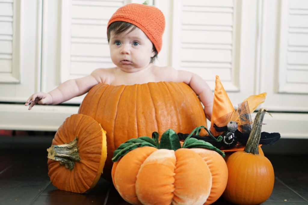baby in a pumpkin